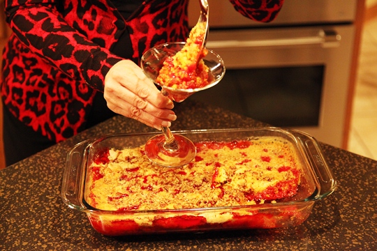 Spooning Cherry Cake Pudding into the Serving dish