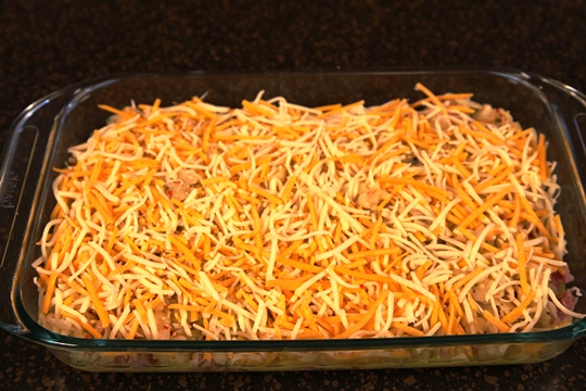 Sprinkle Cheese on Top of Sunrise Breakfast Casserole