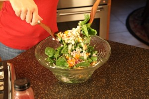 Toss Spinach Salad Ingredients Together