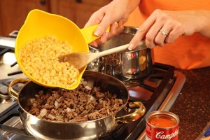 Add Cooked Macaroni to the Beef and Onion Mixture